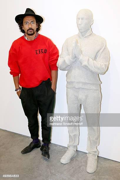 Fashion designer Haider Ackermann near the work of contemporary artist Daniel Arsham attends the Pharrell Williams' Private Concert at Galerie...
