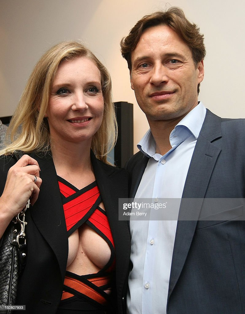 Fashion designer Henriette Elisabeth Joop, known as Jette Joop, (L) poses with her husband Christian Elsen on September 26, 2012 at the official opening party of the Google offices in Berlin, Germany. Although the American company holds 95% of the German search engine market share and already has offices in Hamburg and Munich, its new offices on the prestigious Unter den Linden avenue are its first in the German capital. The Internet giant has been met with opposition in the country recently by the former president's wife, who has sued it based on search results for her name that she considers derogative. The European Commission has planned new data privacy regulations in a country where many residents opted in to have their homes pixeled out when the company introduced its Street View technology.