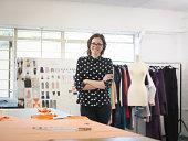 Fashion designer in fashion design studio, portrait