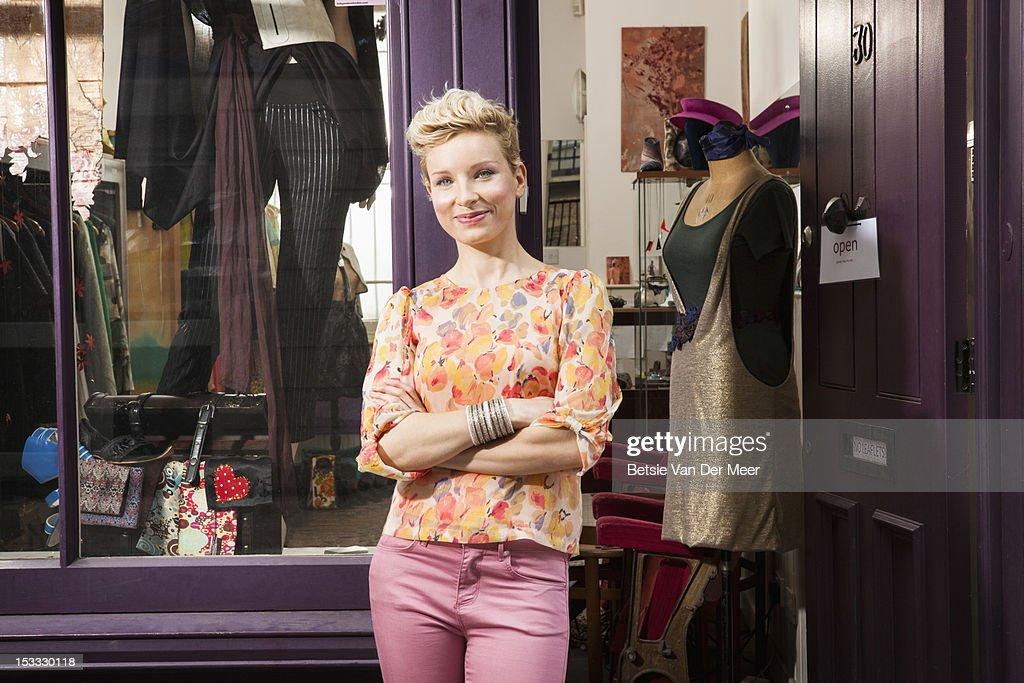 Fashion designer in front of designer shop : Stock Photo
