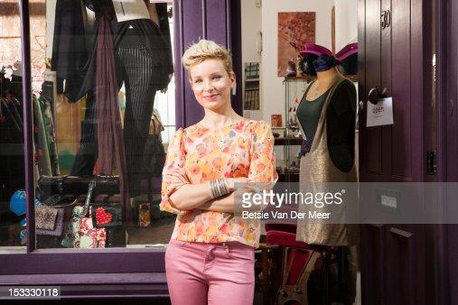 Fashion designer in front of designer shop
