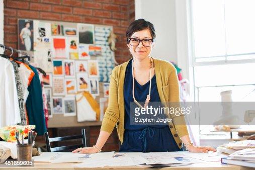 Fashion designer in her studio : Stock Photo