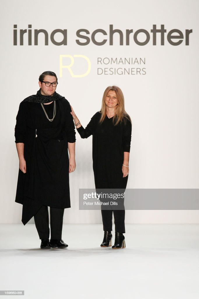 Fashion designer Irina Schrotter (R) after her show on the Runway at Irina Schrotter Autumn/Winter 2013/14 fashion show during Mercedes-Benz Fashion Week Berlin at Brandenburg Gate on January 18, 2013 in Berlin, Germany.