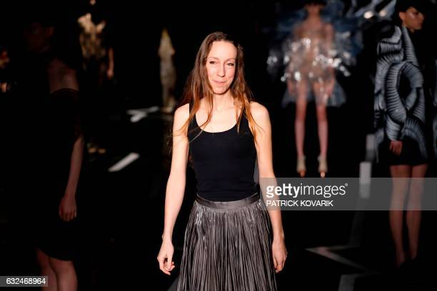 Fashion designer Iris Van Herpen acknowledges the audience at the end of the 2017 spring/summer Haute Couture collection on January 23 2017 in Paris...