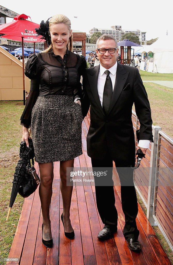 Fashion designer Jayson Brunsdon and TV host Charlotte Dawson arrive at the David Jones marquee at the David Jones Australian Derby Day the first day...