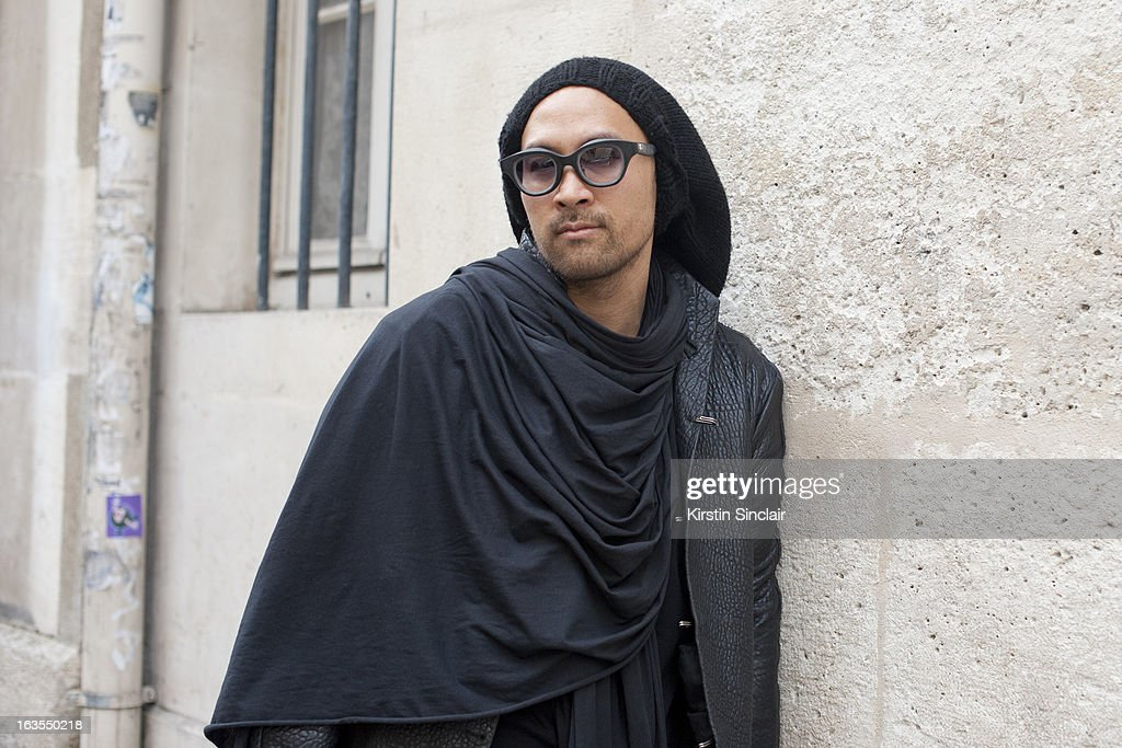 Fashion designer Jean Marc Virard wears Rigards sunglasses, JMV, Jean Marc Virard hat, BR, Beautiful Ruins jacket and scarf, Rick Owens shirt on day 7 of Paris Womens Fashion Week Autumn/Winter 2013 on March 06, 2013 in Paris, France.