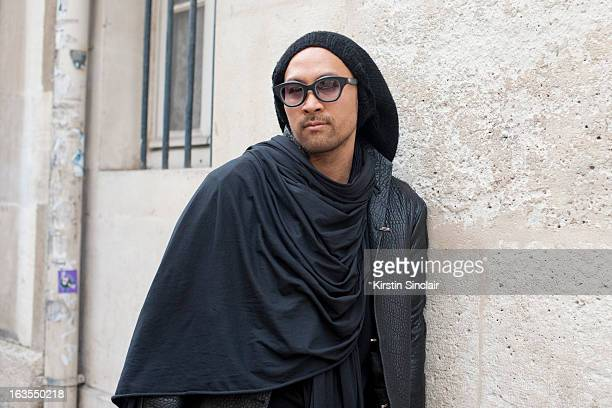 Fashion designer Jean Marc Virard wears Rigards sunglasses JMV Jean Marc Virard hat BR Beautiful Ruins jacket and scarf Rick Owens shirt on day 7 of...