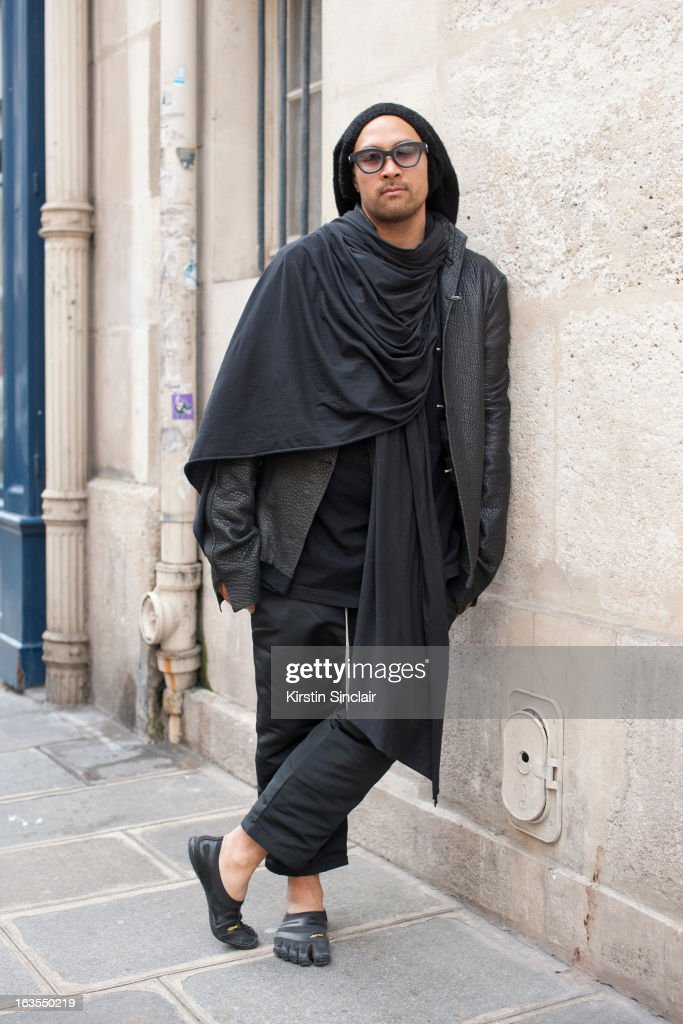 Fashion designer Jean Marc Virard wears Rigards sunglasses, JMV, Jean Marc Virard hat, BR, Beautiful Ruins jacket and scarf, Rick Owens shirt and pants,Rolex watch and Vibram 5 Fingers shoes on day 7 of Paris Womens Fashion Week Autumn/Winter 2013 on March 06, 2013 in Paris, France.