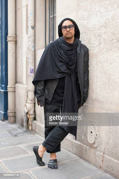Fashion designer Jean Marc Virard wears Rigards sunglasses JMV Jean Marc Virard hat BR Beautiful Ruins jacket and scarf Rick Owens shirt and...