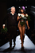 Fashion designer Jean Paul Gaultier and model Naomi Campbell walk the runway at the end of the Jean Paul Gaultier show as part of Paris Fashion Week...