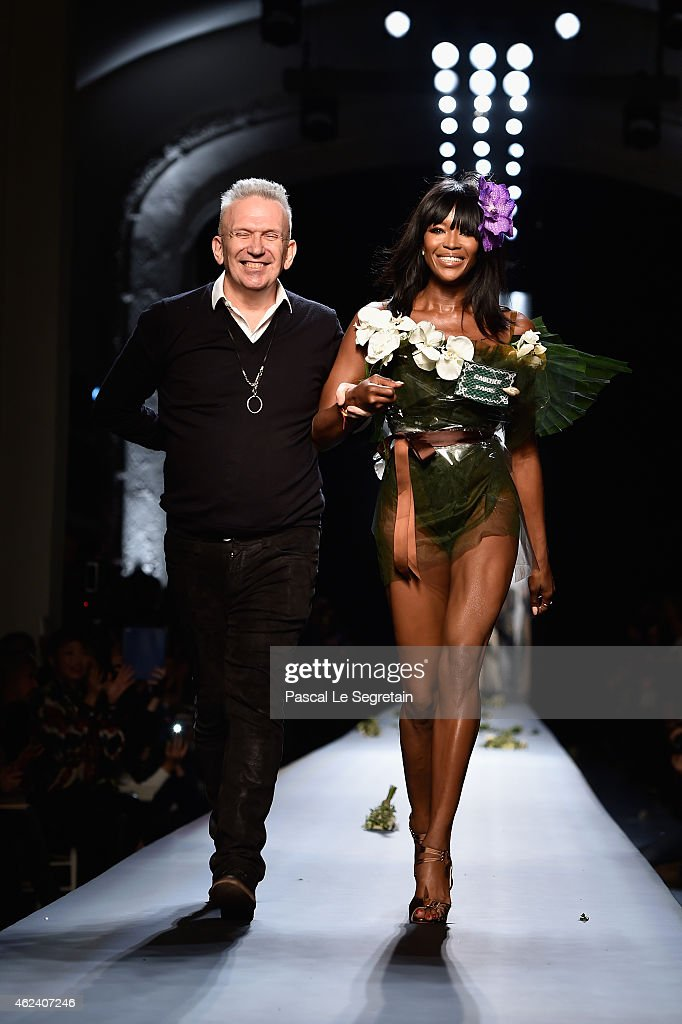 Fashion designer Jean Paul Gaultier and model Naomi Campbell walk the runway at the end of the Jean Paul Gaultier show as part of Paris Fashion Week Haute Couture Spring/Summer 2015 on January 28, 2015 in Paris, France.