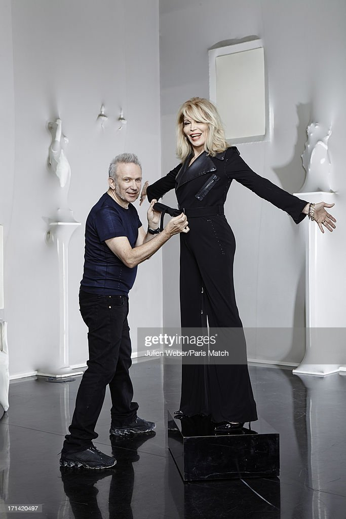 Fashion designer <a gi-track='captionPersonalityLinkClicked' href=/galleries/search?phrase=Jean+Paul+Gaultier+-+Fashion+Designer&family=editorial&specificpeople=4310036 ng-click='$event.stopPropagation()'>Jean Paul Gaultier</a> and singer <a gi-track='captionPersonalityLinkClicked' href=/galleries/search?phrase=Amanda+Lear&family=editorial&specificpeople=2028746 ng-click='$event.stopPropagation()'>Amanda Lear</a> are photographed for Paris Match on June 11, 2013 in Paris, France.
