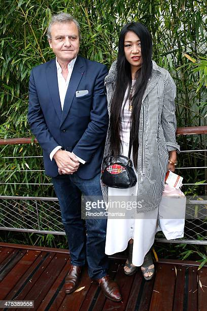 Fashion Designer JeanCharles de Castelbajac and his companion Jewelry Designer Ai Canno attend the 2015 Roland Garros French Tennis Open Day Eight on...