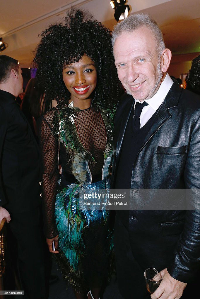 Fashion Designer Jean-Paul Gaultier (R) and Guest attend the Annual Charity Dinner hosted by the AEM Association Children of the World for Rwanda on December 17, 2013. Held at Espace Pierre Cardin in Paris, France.