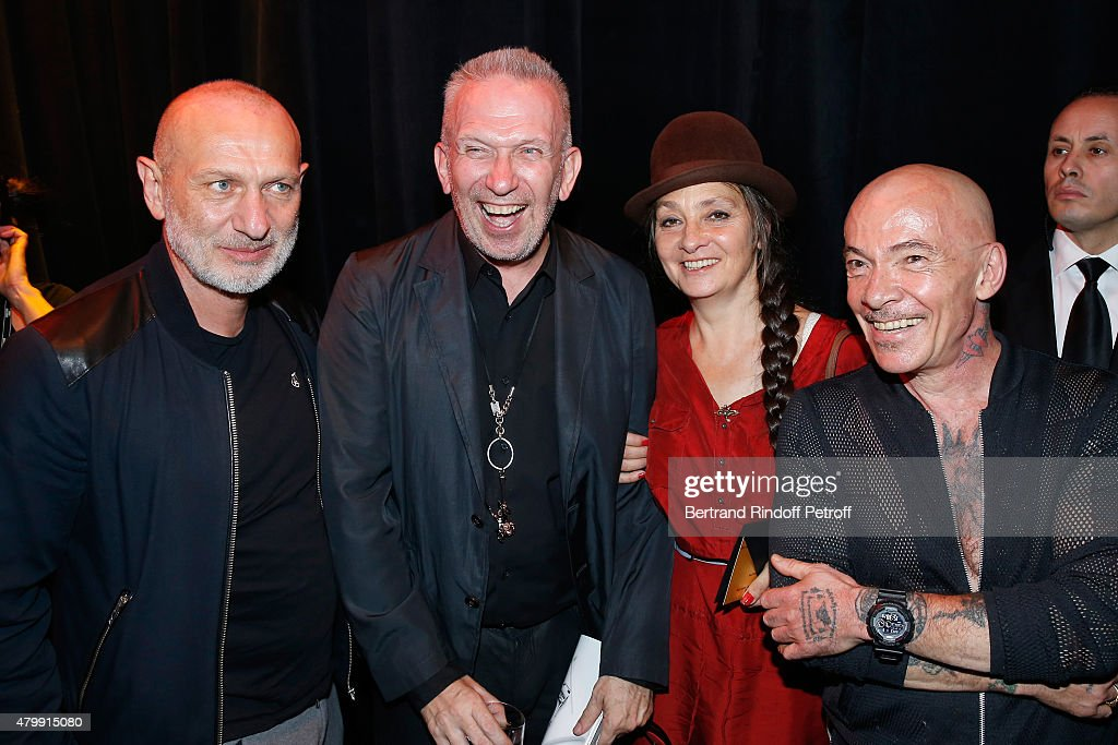 Fashion Designer Jean-Paul Gaultier and Singer catherine Ringer standing between Artists 'Pierre et Gilles' pose Backstage after the <a gi-track='captionPersonalityLinkClicked' href=/galleries/search?phrase=Jean+Paul+Gaultier+-+Stilista+di+moda&family=editorial&specificpeople=4310036 ng-click='$event.stopPropagation()'>Jean Paul Gaultier</a> show as part of Paris Fashion Week Haute-Couture Fall/Winter 2015/2016 on July 8, 2015 in Paris, France.