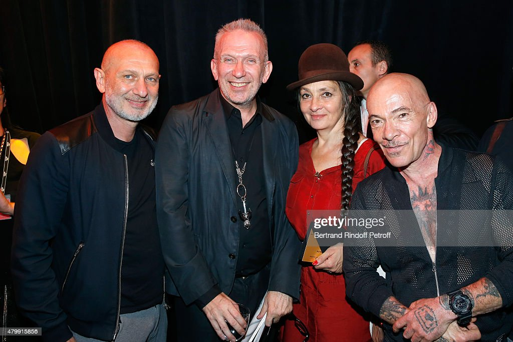 Fashion Designer Jean-Paul Gaultier and Singer catherine Ringer standing between Artists 'Pierre et Gilles' pose Backstage after the <a gi-track='captionPersonalityLinkClicked' href=/galleries/search?phrase=Jean+Paul+Gaultier+-+Fashion+Designer&family=editorial&specificpeople=4310036 ng-click='$event.stopPropagation()'>Jean Paul Gaultier</a> show as part of Paris Fashion Week Haute-Couture Fall/Winter 2015/2016 on July 8, 2015 in Paris, France.