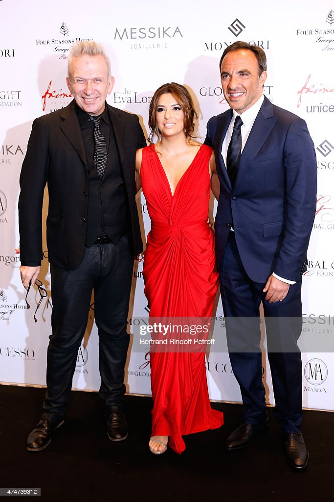 Fashion designer Jean-Paul Gaultier, <a gi-track='captionPersonalityLinkClicked' href=/galleries/search?phrase=Eva+Longoria&family=editorial&specificpeople=202082 ng-click='$event.stopPropagation()'>Eva Longoria</a> and Journalist <a gi-track='captionPersonalityLinkClicked' href=/galleries/search?phrase=Nikos+Aliagas&family=editorial&specificpeople=573643 ng-click='$event.stopPropagation()'>Nikos Aliagas</a> attend the Global Gift Gala : Photocall. Held at Four Seasons Hotel George V on May 25, 2015 in Paris, France.