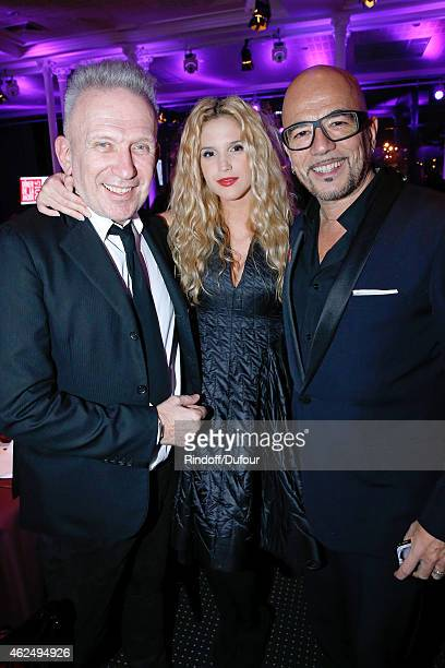 Fashion Designer JeanPaul Gaultier Singer Pascal Obispo and his companion Julie Hantson attend the Sidaction Gala Dinner 2015 at Pavillon...