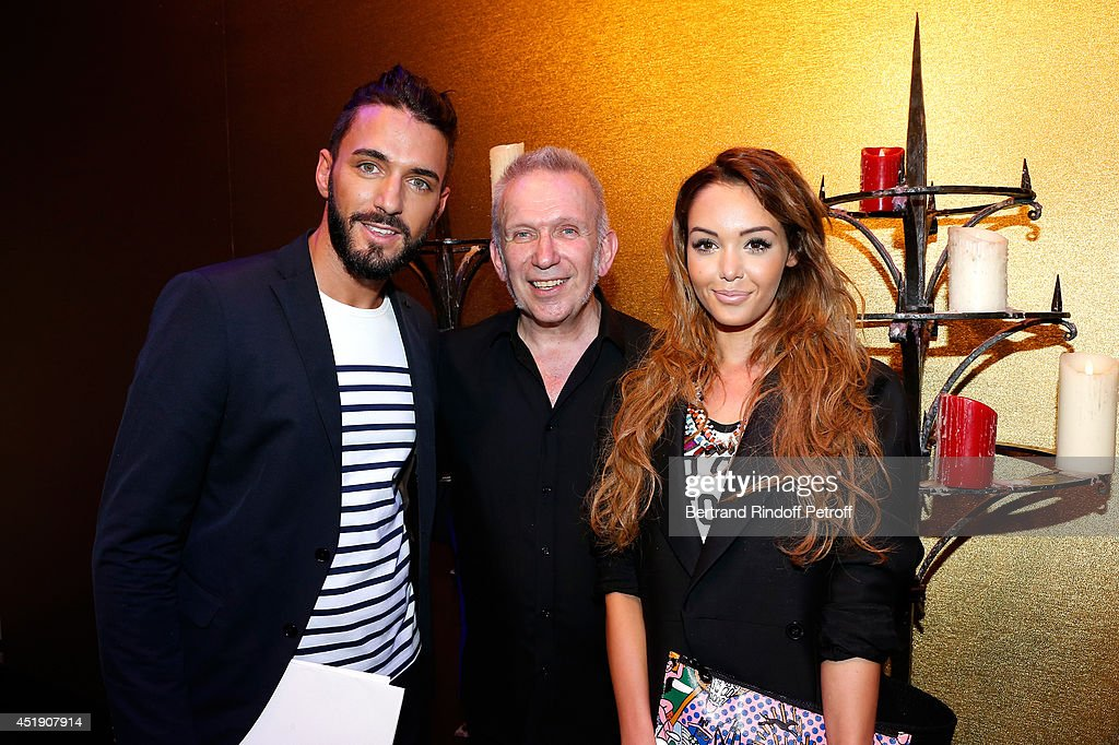 Fashion designer Jean-Paul Gaultier standing between <a gi-track='captionPersonalityLinkClicked' href=/galleries/search?phrase=Nabilla+Benattia&family=editorial&specificpeople=9537253 ng-click='$event.stopPropagation()'>Nabilla Benattia</a> and Thomas Vergara pose after the <a gi-track='captionPersonalityLinkClicked' href=/galleries/search?phrase=Jean+Paul+Gaultier+-+Fashion+Designer&family=editorial&specificpeople=4310036 ng-click='$event.stopPropagation()'>Jean Paul Gaultier</a> show as part of Paris Fashion Week - Haute Couture Fall/Winter 2014-2015. Held at 325 Rue Saint Martin on July 9, 2014 in Paris, France.