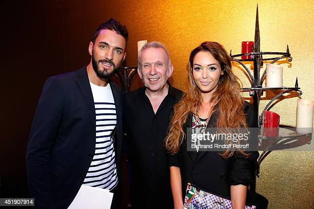 Fashion designer JeanPaul Gaultier standing between Nabilla Benattia and Thomas Vergara pose after the Jean Paul Gaultier show as part of Paris...