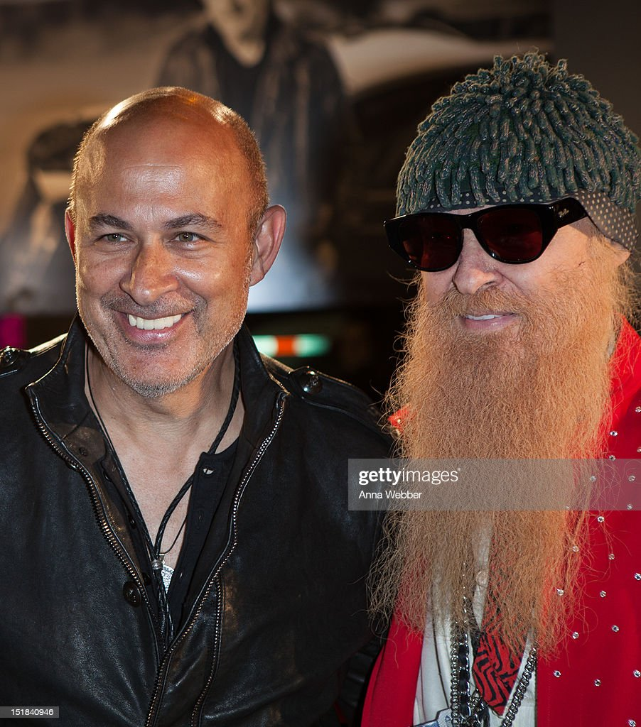 Fashion designer John Varvatos and Musician <a gi-track='captionPersonalityLinkClicked' href=/galleries/search?phrase=Billy+Gibbons&family=editorial&specificpeople=242873 ng-click='$event.stopPropagation()'>Billy Gibbons</a> of ZZ Top arrives to GQ, Chrysler, And John Varvatos Celebrate The Launch Of The 2013 Chrysler 300C on September 11, 2012 in New York City.