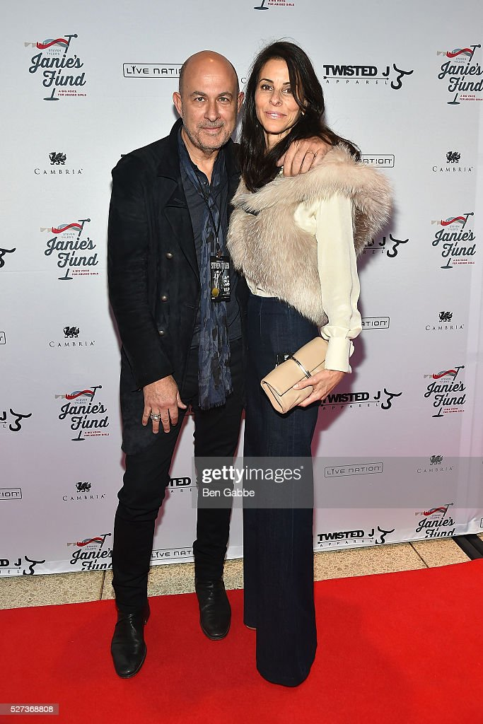 Fashion designer John Varvatos (L) and wife <a gi-track='captionPersonalityLinkClicked' href=/galleries/search?phrase=Joyce+Varvatos&family=editorial&specificpeople=731977 ng-click='$event.stopPropagation()'>Joyce Varvatos</a> attend the Steven Tyler...Out On A Limb Benefit Concert on May 02, 2016 in New York, New York.