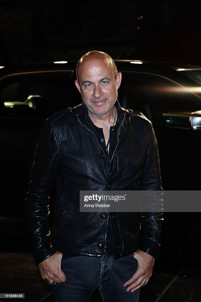 Fashion designer John Varvatos arrives to GQ, Chrysler, And John Varvatos Celebrate The Launch Of The 2013 Chrysler 300C on September 11, 2012 in New York City.
