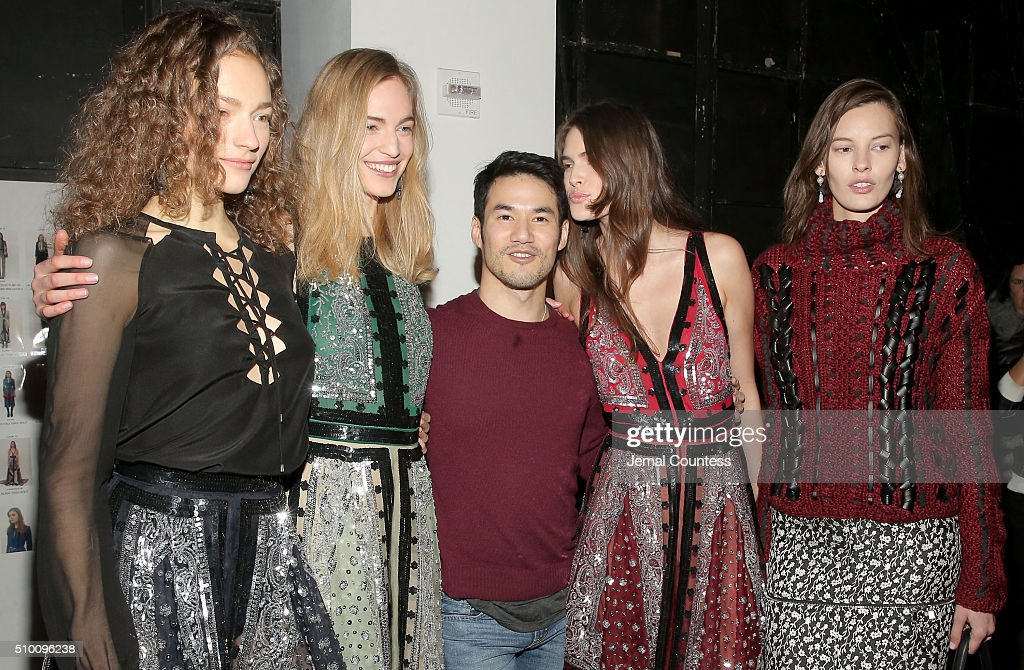 Fashion designer <a gi-track='captionPersonalityLinkClicked' href=/galleries/search?phrase=Joseph+Altuzarra+-+Fashion+Designer&family=editorial&specificpeople=5710924 ng-click='$event.stopPropagation()'>Joseph Altuzarra</a> (C) and model appear backstage at the Altuzarra Fall 2016 fashion show during New York Fashion Week at Spring Studios on February 13, 2016 in New York City.