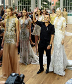Fashion designer Julien Macdonald on the the runway after his show during London Fashion Week Spring Summer 2015 at the Royal Opera House on...