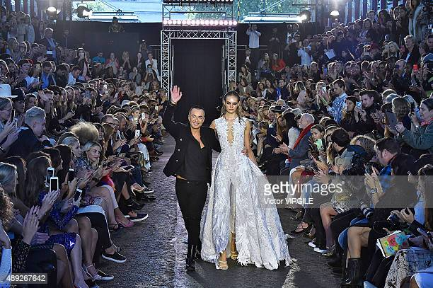 Fashion designer Julien MacDonald walks the runway at the Julien MacDonald Ready to Wear Spring/Summer 2016 show as part of the London Fashion Week...