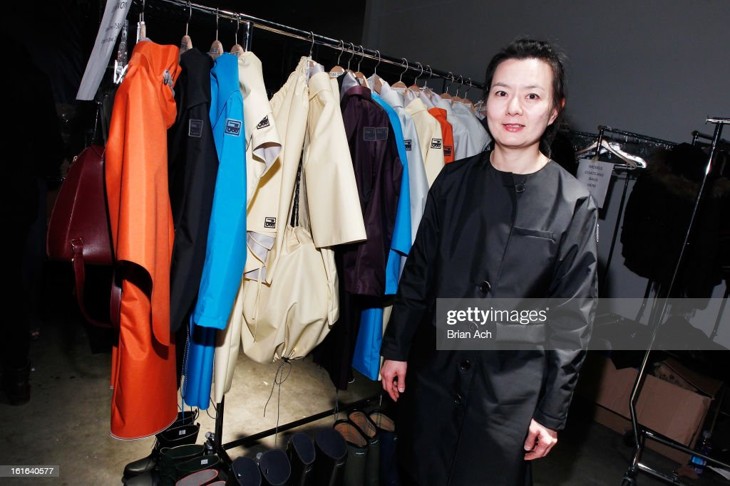 Fashion designer June Sohn poses backstage at Nolcha Fashion Week New York 2013 presented by RUSK at Pier 59 Studios on February 13, 2013 in New York City.