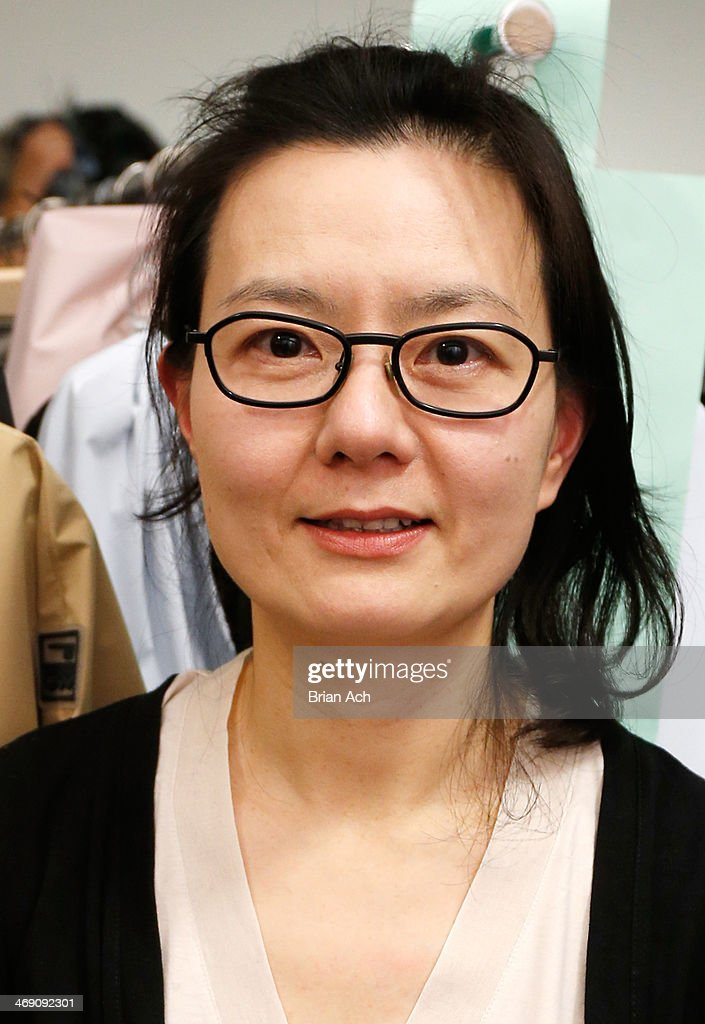 Fashion designer June Sohn poses backstage at the Jungwon show during Nolcha Fashion Week New York Fall/Winter 2014 at Pier 59 on February 12, 2014 in New York City.