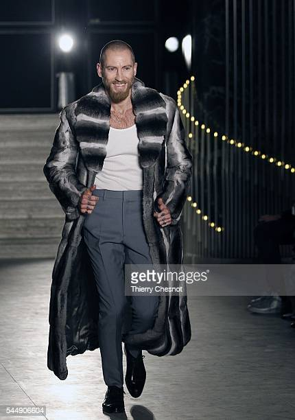 Fashion designer Justin O'Shea walks the runway at the end of the Brioni Haute Couture Fall/Winter 20162017 show as part of Paris Fashion Week on...