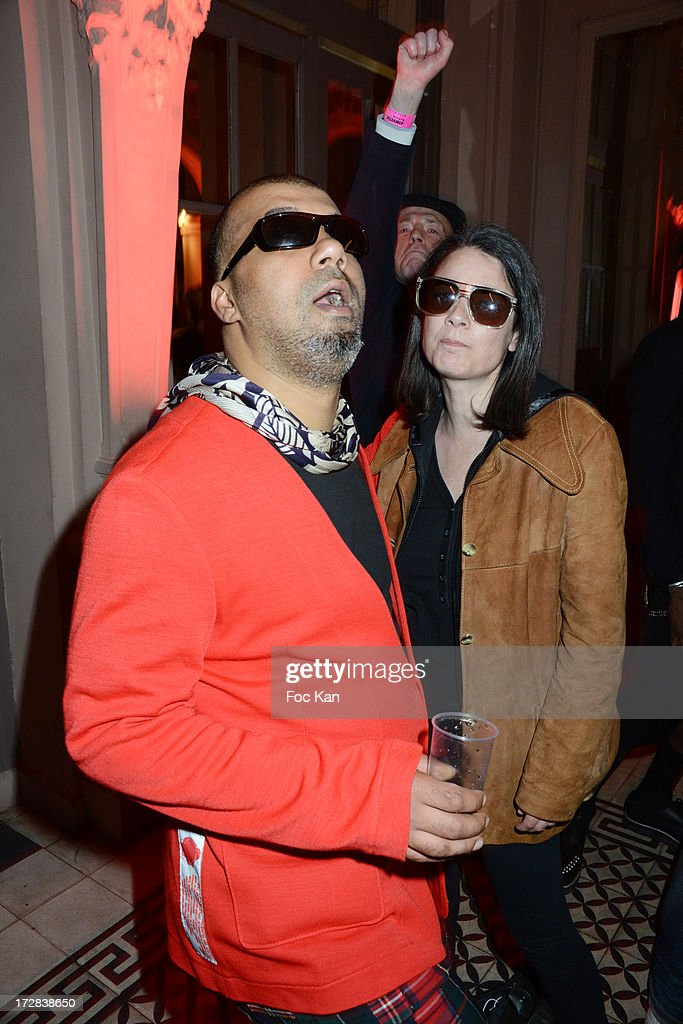 Fashion designer Karim Bonnet from 'Impasse De La Defense' and a guestattend the 'Invisible Tour' Marc By Marc Jacobs Party At Le Trianon on July 4...