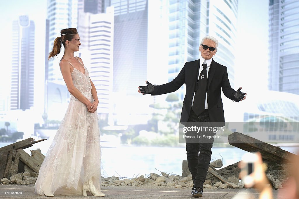 Fashion designer Karl Lagerfeld acknowledges applause following the Chanel show as part of Paris Fashion Week Haute-Couture Fall/Winter 2013-2014 at Grand Palais on July 2, 2013 in Paris, France.