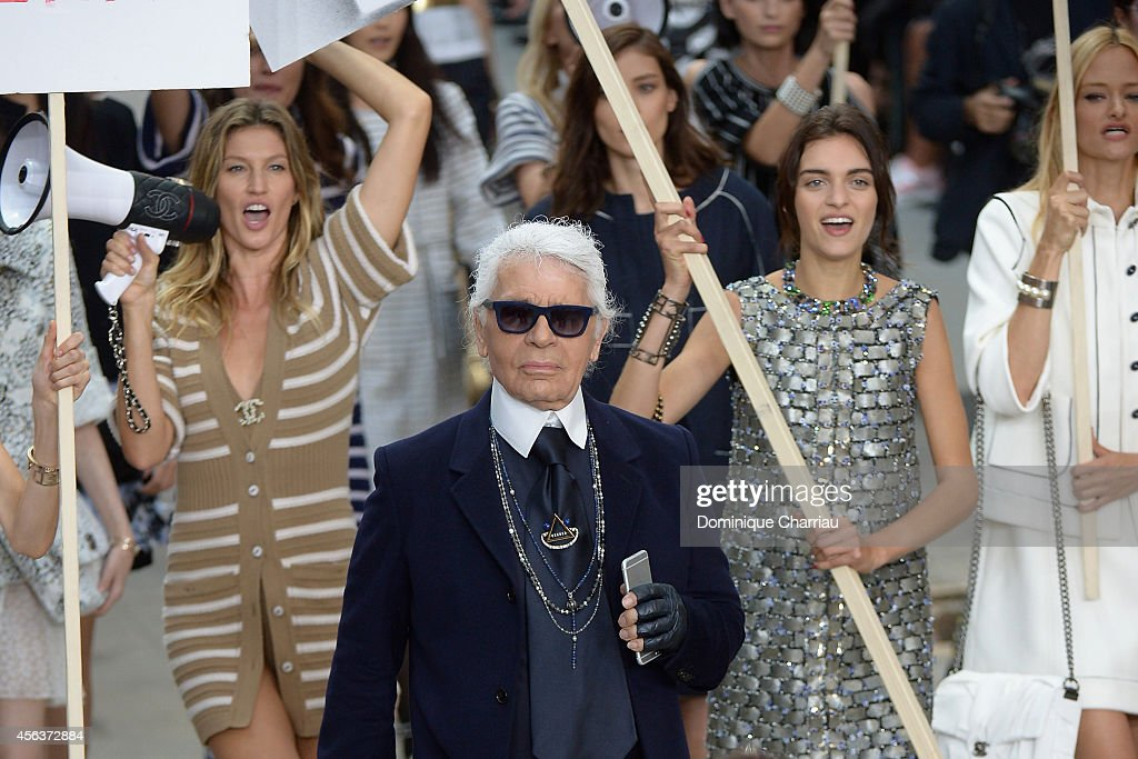 Fashion designer <a gi-track='captionPersonalityLinkClicked' href=/galleries/search?phrase=Karl+Lagerfeld+-+Fashion+Designer&family=editorial&specificpeople=4330565 ng-click='$event.stopPropagation()'>Karl Lagerfeld</a> (C) aknowledges the applause of the audience after the Chanel show as part of the Paris Fashion Week Womenswear Spring/Summer 2015 on September 30, 2014 in Paris, France.