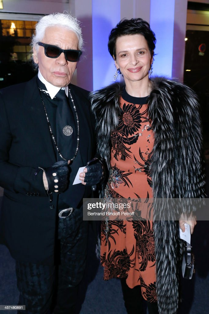 Fashion Designer <a gi-track='captionPersonalityLinkClicked' href=/galleries/search?phrase=Karl+Lagerfeld+-+Fashion+Designer&family=editorial&specificpeople=4330565 ng-click='$event.stopPropagation()'>Karl Lagerfeld</a> and Actress <a gi-track='captionPersonalityLinkClicked' href=/galleries/search?phrase=Juliette+Binoche&family=editorial&specificpeople=209273 ng-click='$event.stopPropagation()'>Juliette Binoche</a> attend the Annual Charity Dinner hosted by the AEM Association Children of the World for Rwanda on December 17, 2013. Held at Espace Pierre Cardin in Paris, France.