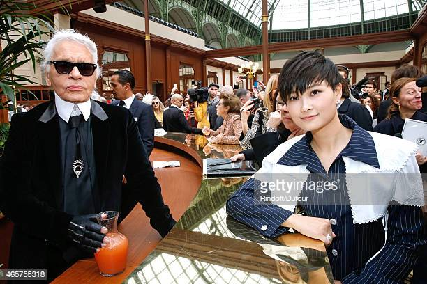 Fashion Designer Karl Lagerfeld and Chinese singer Chris Lee pose after the Chanel show as part of the Paris Fashion Week Womenswear Fall/Winter...