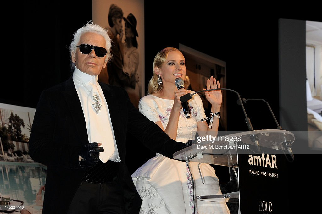Fashion designer <a gi-track='captionPersonalityLinkClicked' href=/galleries/search?phrase=Karl+Lagerfeld&family=editorial&specificpeople=4330565 ng-click='$event.stopPropagation()'>Karl Lagerfeld</a> (L) and <a gi-track='captionPersonalityLinkClicked' href=/galleries/search?phrase=Diane+Kruger&family=editorial&specificpeople=202640 ng-click='$event.stopPropagation()'>Diane Kruger</a> speak during the 2012 amfAR's Cinema Against AIDS during the 65th Annual Cannes Film Festival at Hotel Du Cap on May 24, 2012 in Cap D'Antibes, France.