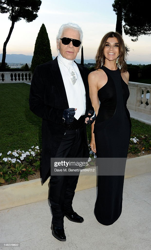 Fashion designer Karl Lagerfeld (L) and Editor in Chief of CR Fashion-Book <a gi-track='captionPersonalityLinkClicked' href=/galleries/search?phrase=Carine+Roitfeld&family=editorial&specificpeople=240177 ng-click='$event.stopPropagation()'>Carine Roitfeld</a> attend the 2012 amfAR's Cinema Against AIDS during the 65th Annual Cannes Film Festival at Hotel Du Cap on May 24, 2012 in Cap D'Antibes, France.