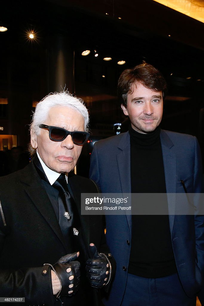 Fashion Designer <a gi-track='captionPersonalityLinkClicked' href=/galleries/search?phrase=Karl+Lagerfeld+-+Fashion+Designer&family=editorial&specificpeople=4330565 ng-click='$event.stopPropagation()'>Karl Lagerfeld</a> and General manager of Berluti <a gi-track='captionPersonalityLinkClicked' href=/galleries/search?phrase=Antoine+Arnault&family=editorial&specificpeople=676045 ng-click='$event.stopPropagation()'>Antoine Arnault</a> attend Berluti Flagship Store Opening on November 26, 2013 in Paris, France.