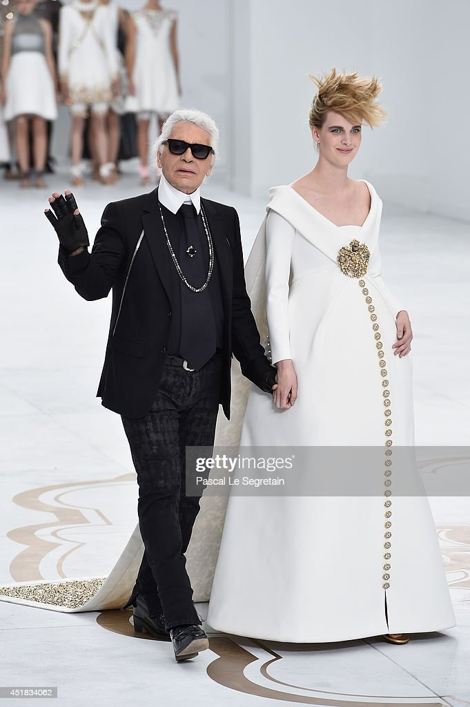 Fashion designer Karl Lagerfeld (L)and model Ashleigh Good aknowledge the applause of the audience after the Chanel show as part of Paris Fashion Week - Haute Couture Fall/Winter 2014-2015 at Grand Palais on July 8, 2014 in Paris, France.