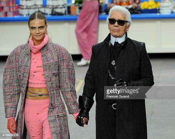 Fashion Designer Karl Lagerfeld and model Cara Delevingne appear at the end of the runway during the Chanel show as part of the Paris Fashion Week...