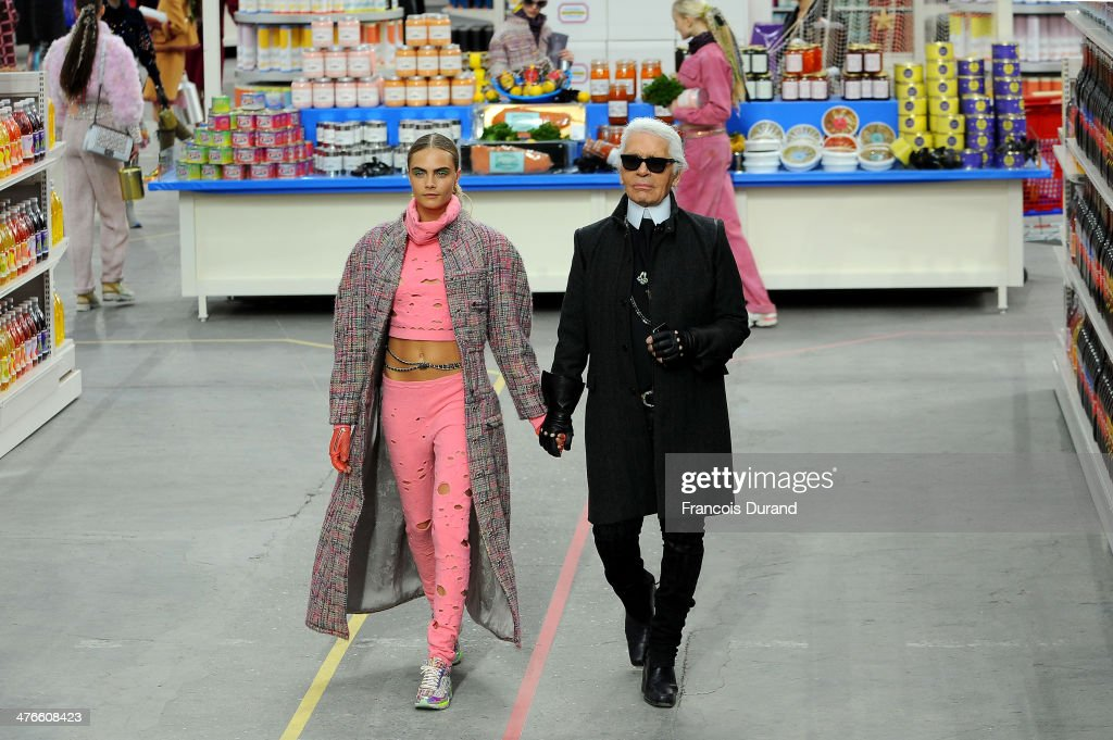 Fashion Designer <a gi-track='captionPersonalityLinkClicked' href=/galleries/search?phrase=Karl+Lagerfeld&family=editorial&specificpeople=4330565 ng-click='$event.stopPropagation()'>Karl Lagerfeld</a> and model <a gi-track='captionPersonalityLinkClicked' href=/galleries/search?phrase=Cara+Delevingne&family=editorial&specificpeople=5488432 ng-click='$event.stopPropagation()'>Cara Delevingne</a> appear at the end of the runway during the Chanel show as part of the Paris Fashion Week Womenswear Fall/Winter 2014-2015 on March 4, 2014 in Paris, France.