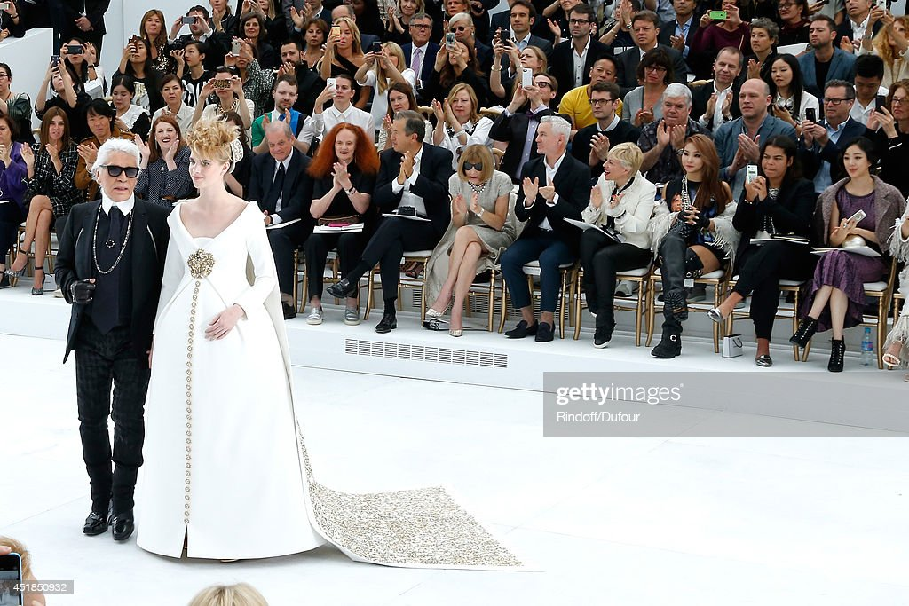Fashion Designer Karl Lagerfeld and pregnant model walk the runway front of Suzy Menkes Carine Roitfeld Grace Coddington Mario Testino Anna Wintour...