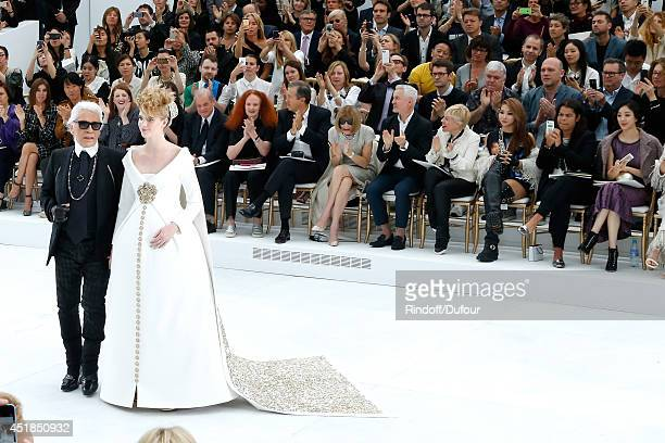 Fashion Designer Karl Lagerfeld and pregnant model walk the runway front of Suzy Menkes Carine Roitfeld Grace Coddington Mario Testino Anna Wintour...