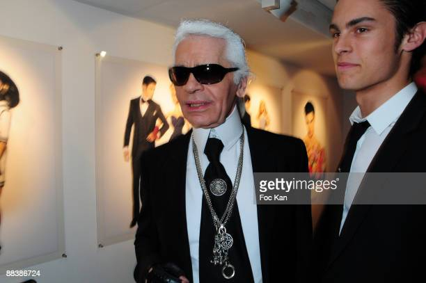 Fashion Designer Karl Lagerfeld and top Model Baptiste Giabiconi attend the Barbie 50th Anniversary Karl Lagerfeld Exhibition Preview Cocktail at...