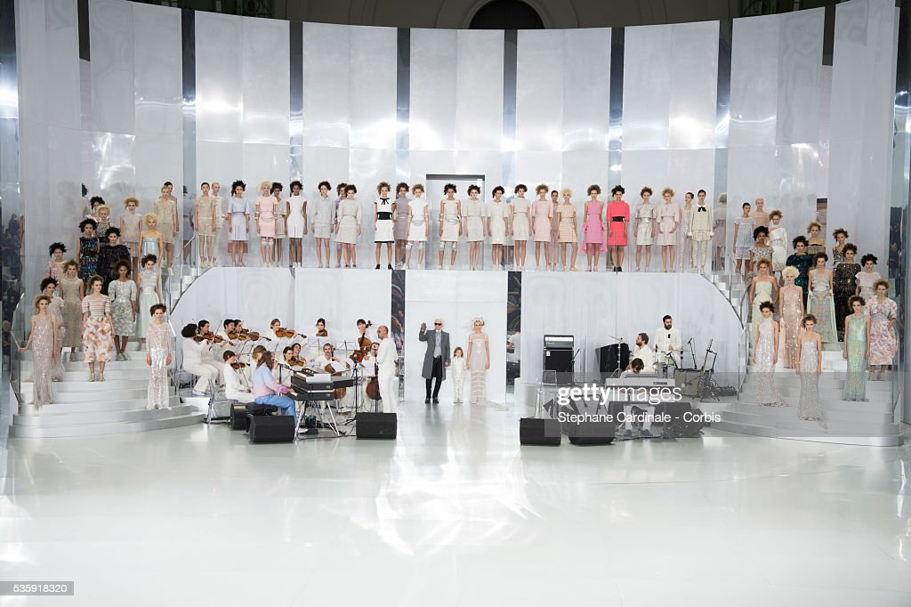 Fashion designer Karl Lagerfeld, his godson Hudson Koening and Model Cara Delevingne walk the runway at the end of the Chanel show as part of Paris Fashion Week Haute-Couture Spring/Summer 2014, at Grand Palais in Paris.
