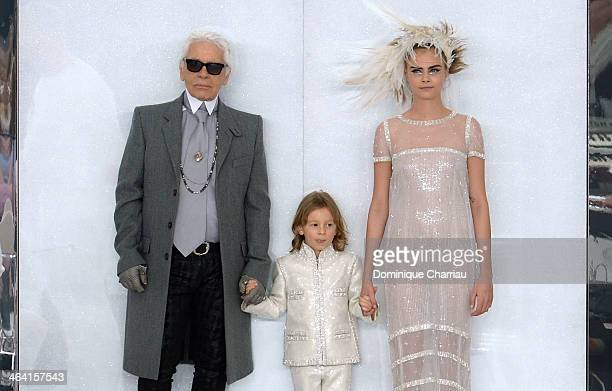 Fashion designer Karl Lagerfeld his godson Hudson Kroenig and model Cara Delevingne walk the runway during the Chanel show as part of Paris Fashion...