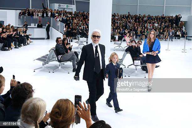 Fashion Designer Karl Lagerfeld Hudson Kroenig and Model Cara Delevingne acknowledge the applause of the audience at the end of the Chanel show as...